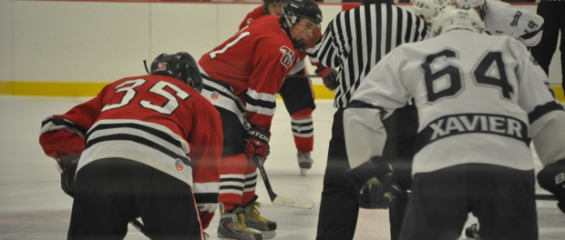 Wittenberg hockey players face off against Xavier.